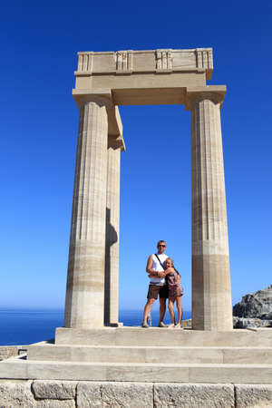 Family posing at Hellenistic stoa of Lindos Acropolis, Rhodes, Greece photo