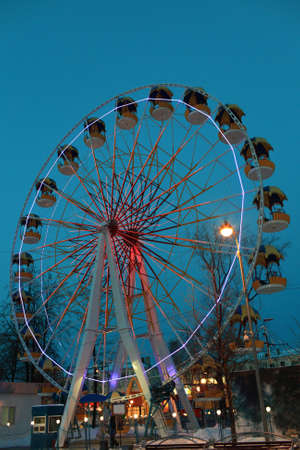 It is Ferris Wheel on the sky background in winter, Tyumen, Russia
