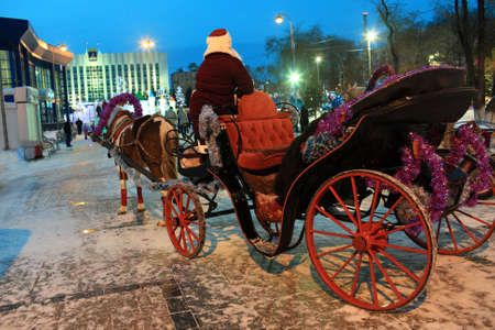 horse drawn carriage: Santa Claus on a horse drawn carriage in Tyumen, Russia
