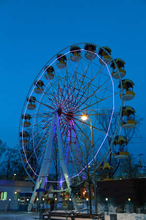 Ferris Wheel in Tyumen at night, Siberia, Russia photo
