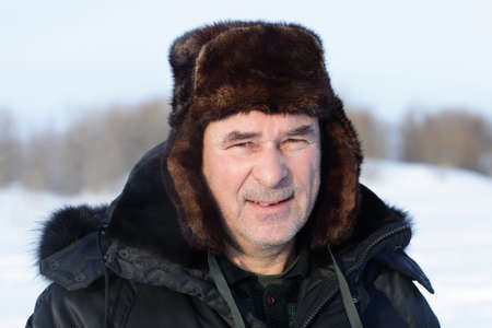 Face of calm senior man in winter photo