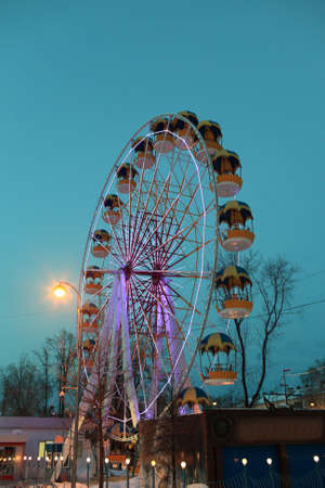 Ferris Wheel in winter at night, Tyumen, Russia photo