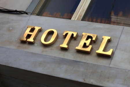 The golden hotel sign in Athens, Greece photo