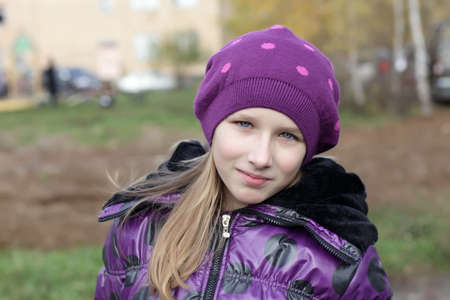 The young girl is posing in the park photo