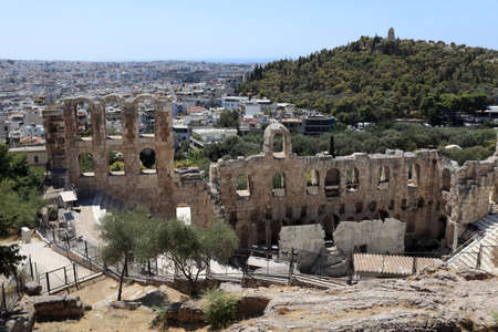 Lanscape of ancient Odeon of Herodes Atticus is located on the south slope of the Acropolis of Athens, Greece photo