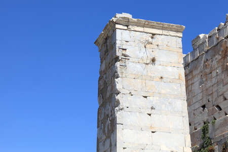 Part of Agrippa tower of the Acropolis Propylaea in summer, Athens, Greece photo
