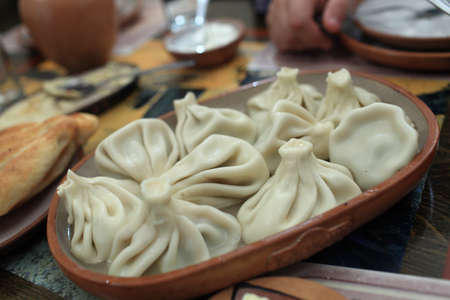 Khinkali in armenian restaurant. It is a dumpling which originated in the Georgia Stock Photo - 17973028