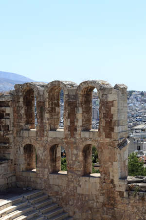 Ruins of wall of Odeon of Herodes Atticus is located on the south slope of the Acropolis of Athens, Greece photo