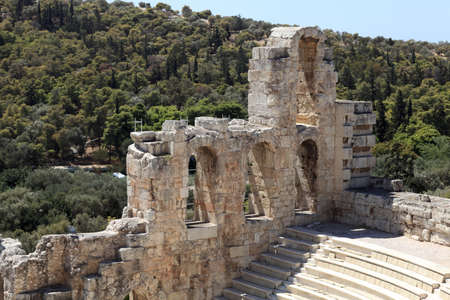 View of ancient Odeon of Herodes Atticus is located on the south slope of the Acropolis of Athens, Greece photo