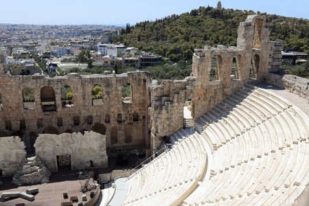 View of Odeon of Herodes Atticus is located on the south slope of the Acropolis of Athens, Greece photo
