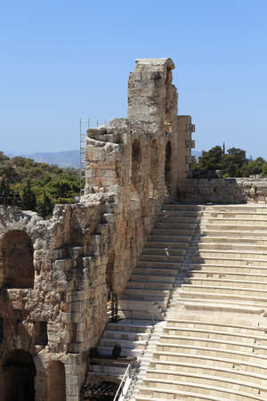 Wall and seats of Odeon of Herodes Atticus is located on the south slope of the Acropolis of Athens, Greece photo
