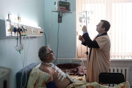 Nurse boy with patient in a hospital ward photo