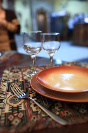 Plates and fork are on a dining table in an armenian restaurant photo