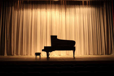 grand piano: Grand piano at concert stage with brown curtain Stock Photo