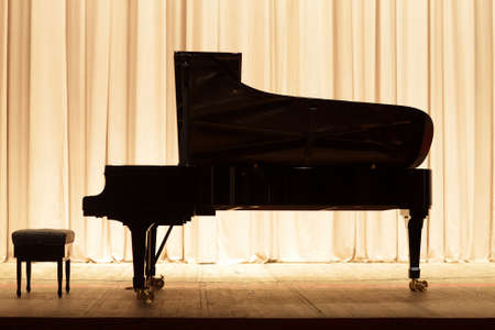 The piano on the brown curtain background Stockfoto