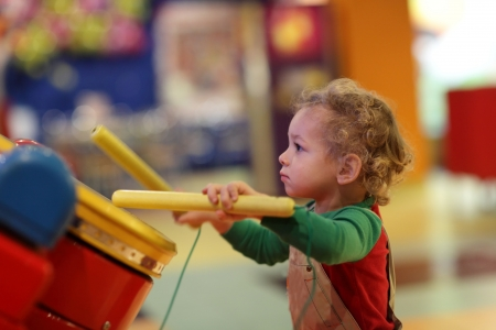The kid drumming in the amusement park