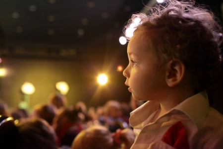 Excited child enjoying time in the theater