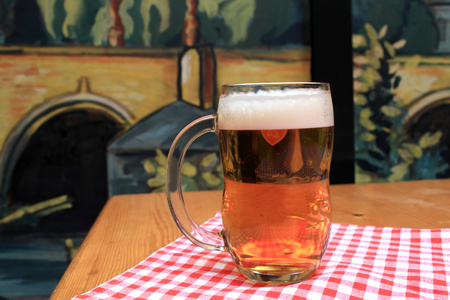 beerglass: Glass of lager beer on the table