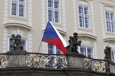 Flag of Czech republic on balcony of old royal palace in Prague photo