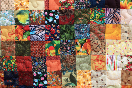 Part of the homemade patchwork as background