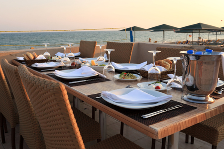 Dining table in the beach restaurant at sunset