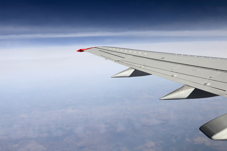 The wing aircraft on the sky background