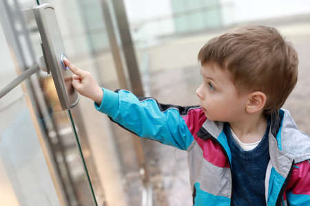 Portrait of child in front of elevator Imagens