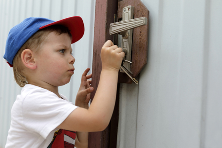Child opening lock of a door with key