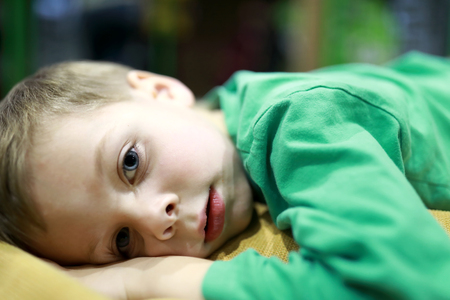 Child lying on the sofa at home