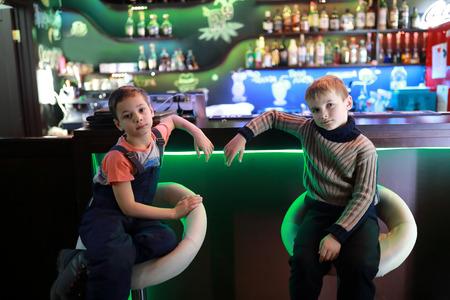Children sitting at bar in a restaurant