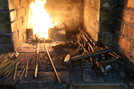 Details of blacksmithing tools in the forge