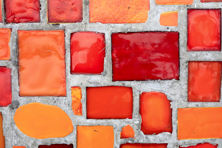 Red mosaic in concrete wall as background