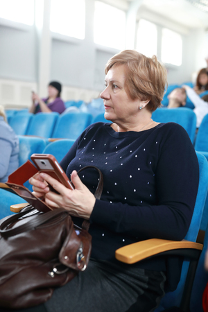 Portrait of elderly woman in the theater