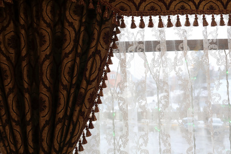 Curtains and tulle on background of window Stock Photo