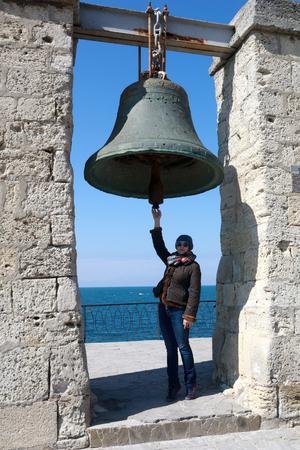 Woman and Chersonesus bell, Peninsula Crimea, Sevastopol
