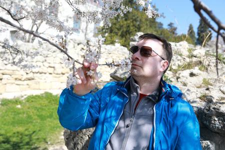 Man enjoying nature in spring apple orchard