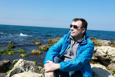 Man posing on shore of the black sea in spring