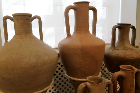 Details of Antique Clay Jugs on window background