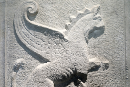 Details of marble slab with a griffin Banco de Imagens