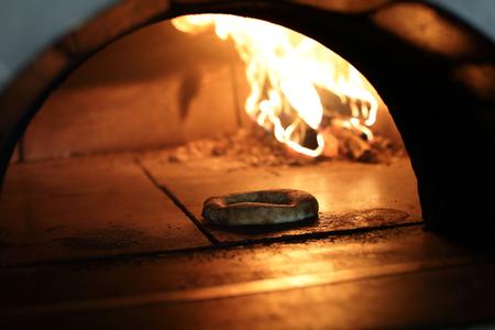 Baking bread in wood oven in restaurant