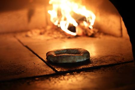 Baking bread cake in wood oven in restaurant Фото со стока