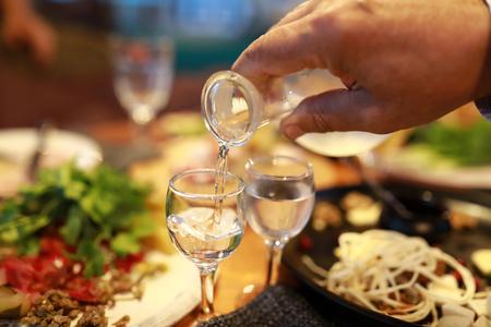 Man pouring vodka into glass in restaurant Stockfoto