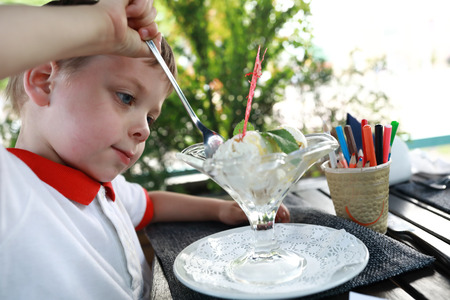 Kid eating ice cream in a restaurant