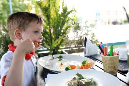 Child eating kebab in the outdoor restaurant Reklamní fotografie