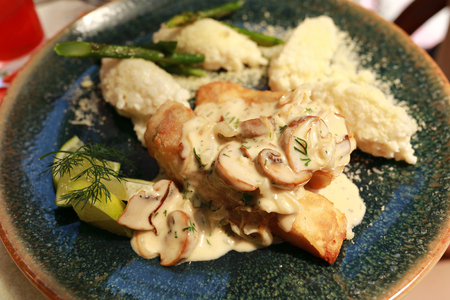 Baked Pikeperch with Mushroom Sauce in restaurant