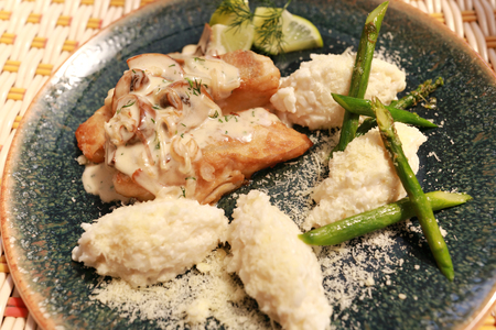 Baked Pikeperch with Mushroom and rice in restaurant