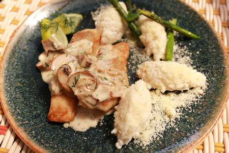 Baked Pikeperch with rice on plate in restaurant Stockfoto