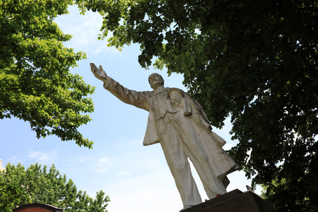 White statue of Vladimir Lenin in the park