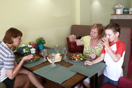 Family has lunch at table in restaurant Reklamní fotografie