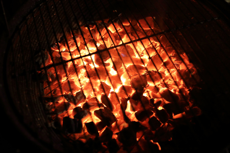 View of burning coals in the grill